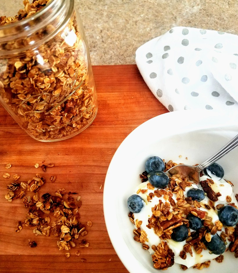 Greek yogurt topped with granola, blueberries and honey