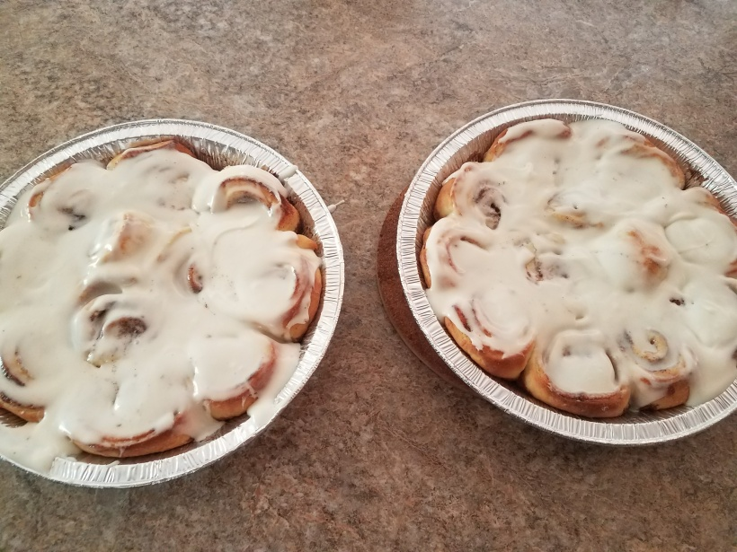 Cinnamon Rolls in 2 foil circular tins freshly baked and out of the oven