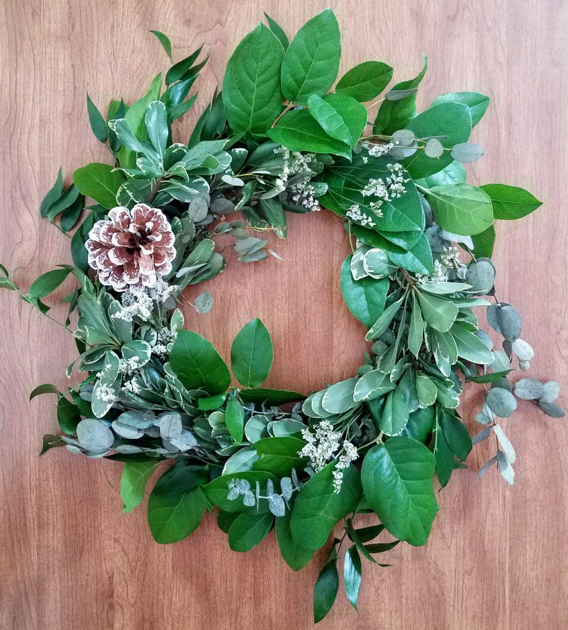 Mixed Greens Wreath with Various Fresh Stems and a Pinecone inserted into the Wreath