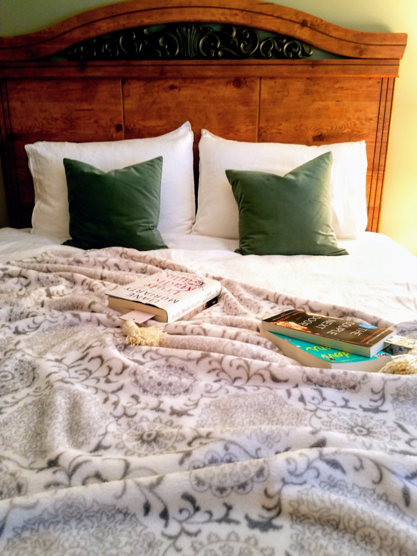 Books Laying On A Bed