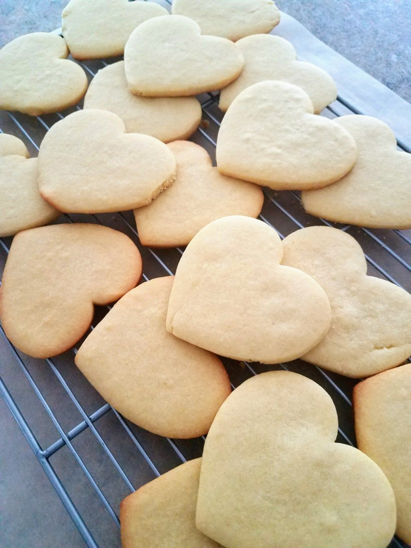 Heart shaped sugar cookies on a cooling rack