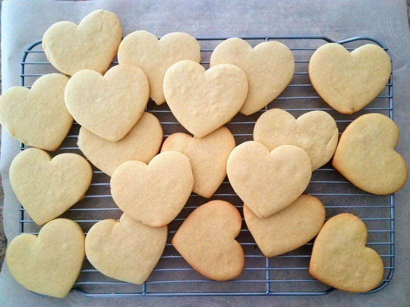 Heart shaped sugar cookies on a cooking rack