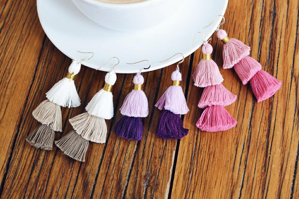 3 set of ombre tassel earrings on a wood table