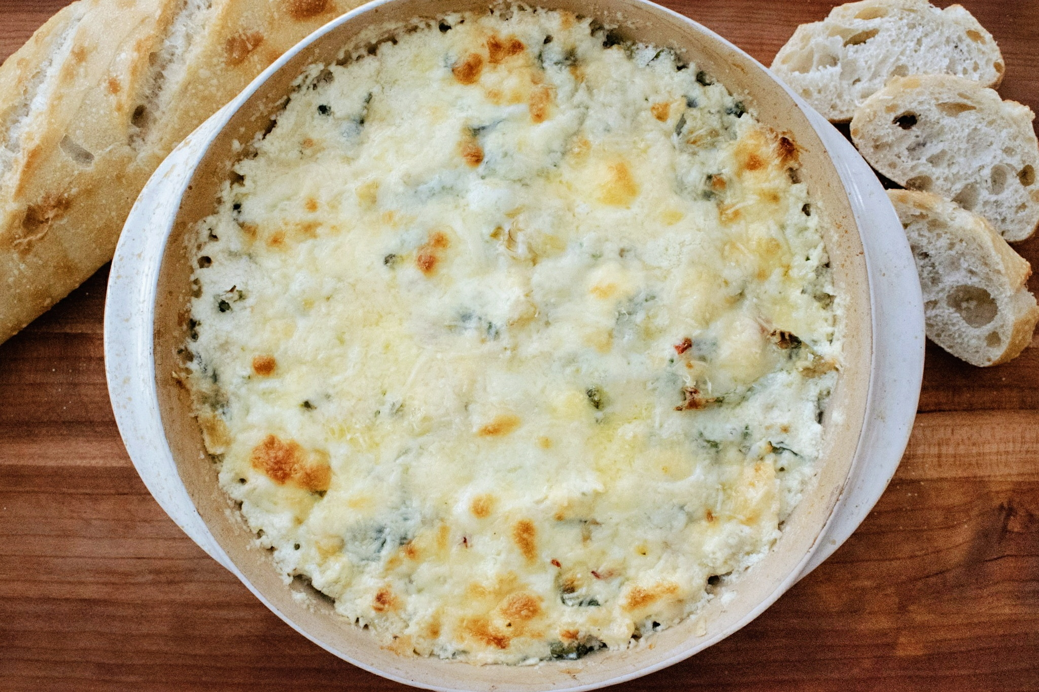Baked Spinach Artichoke Dip with baguette
