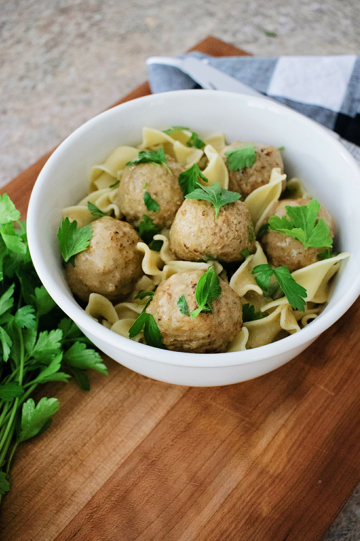 Egg Noodles topped with swedish meatballs and a sprinkle of parsley