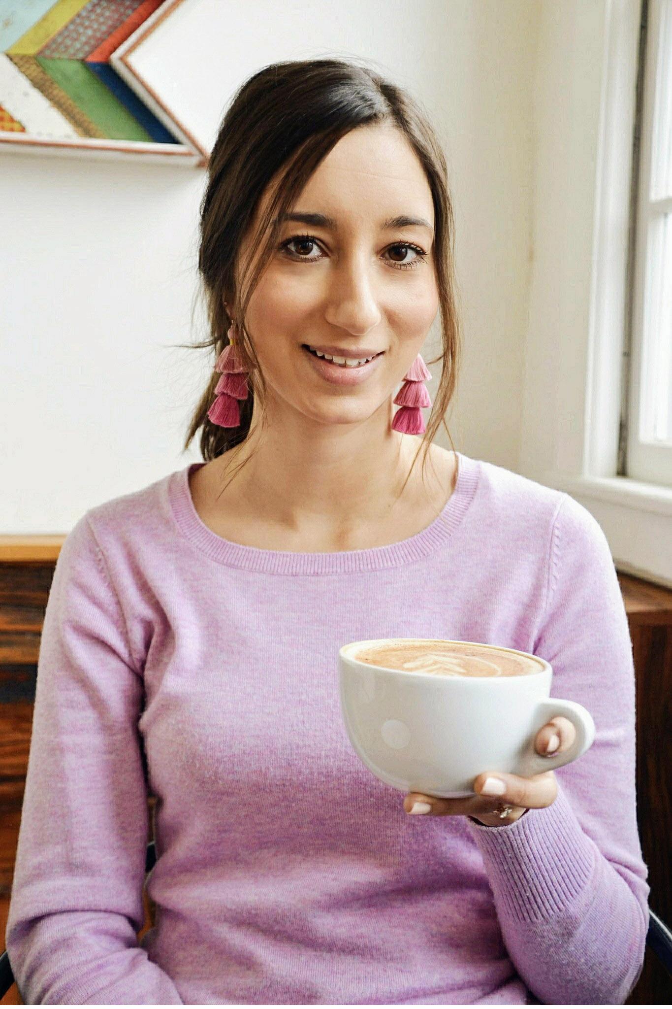 Wearing ombre pink tassel earrings and drinking chai tea latte at Origin Coffee in Saranac Lake, New York