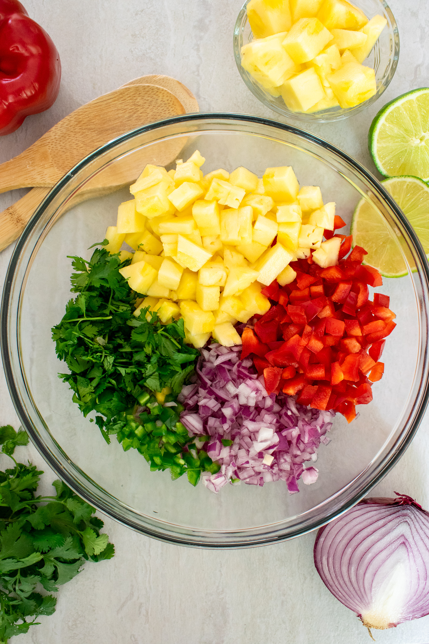 Ingredients for pineapple salsa laid out on a kitchen counter.