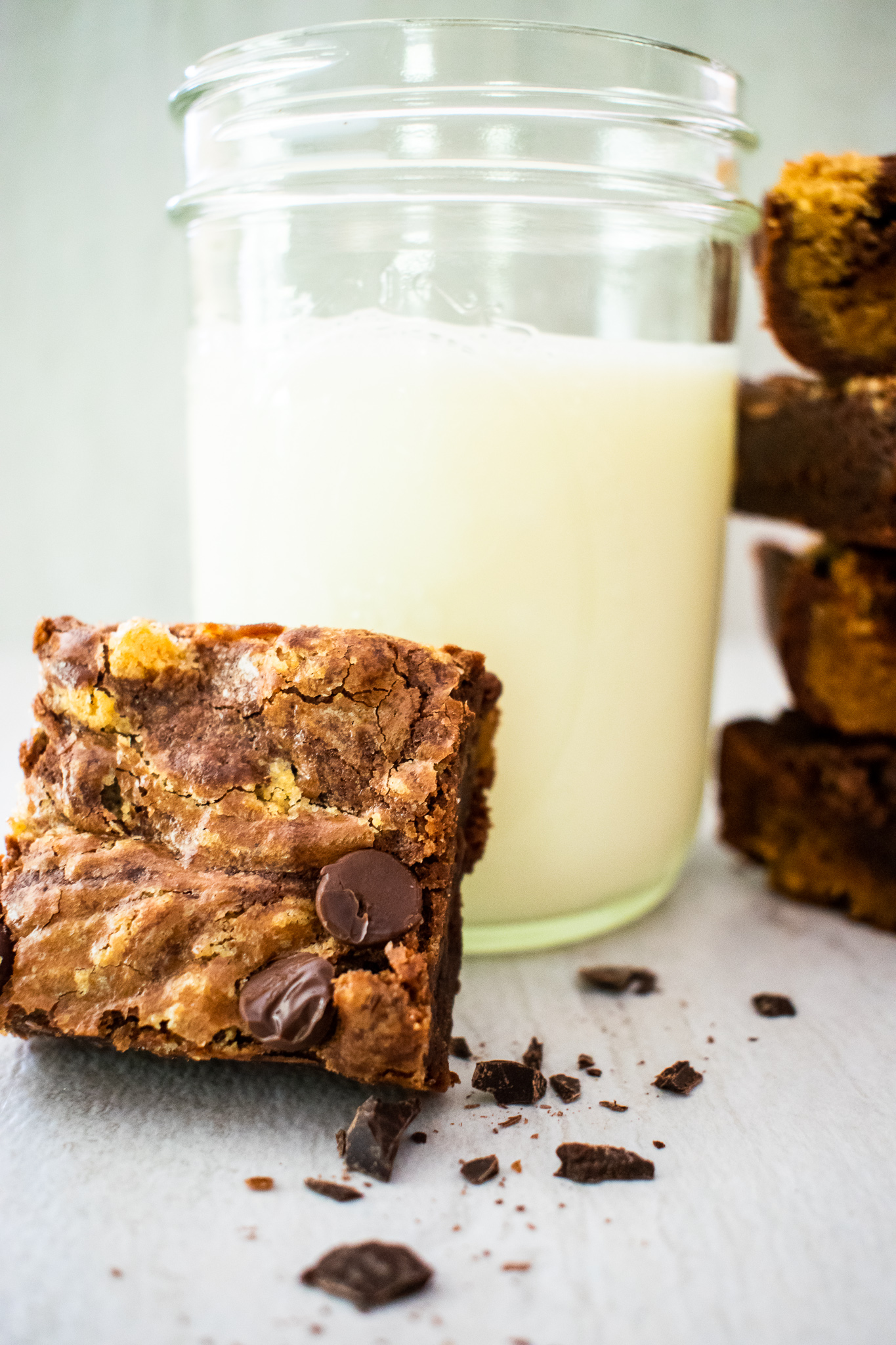 Peanut Butter Brownies leaned up against a mason jar filled with milk
